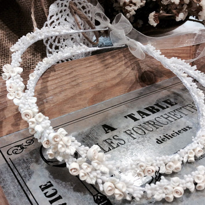 Old fashion wedding crowns in ivory with porcelain flowery